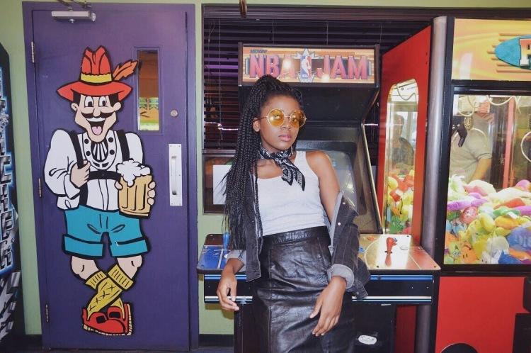 yellow sunglasses- black bandana-grey tank top- black leather skirt- black denim jacket