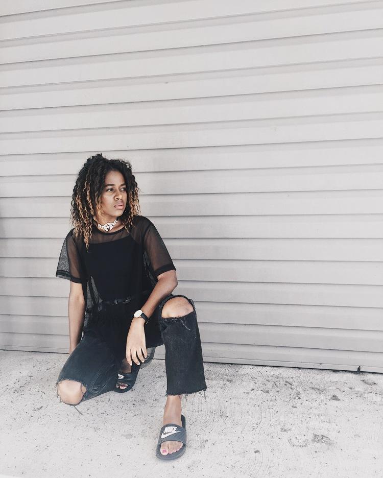 black destroyed denim jeans, mesh top, black tank top, nike slides, diamond choker
