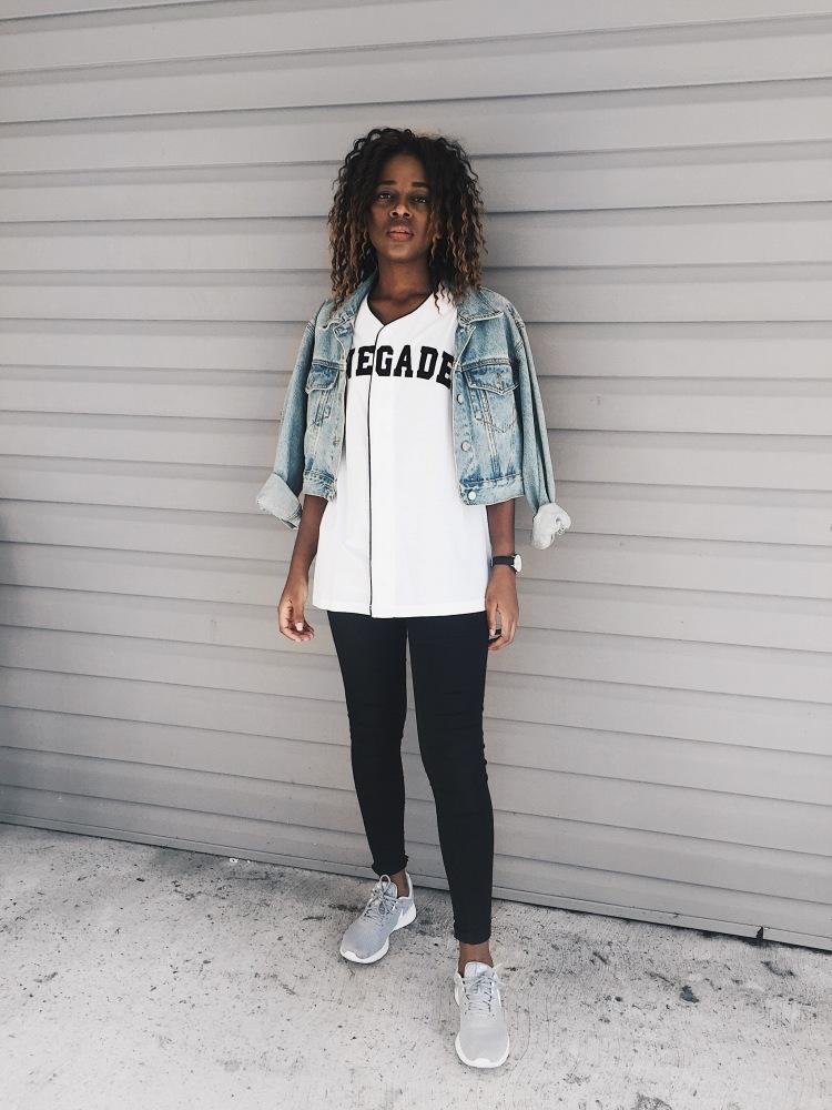 light wash cropped denim jacket, white baseball t-shirt, black begging from American Eagle, grey Nike roshe sneakers